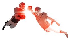 Composite image of american football player scoring a touchdown Royalty Free Stock Photos