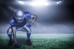 Composite image of american football player in uniform bending with 3d Royalty Free Stock Image
