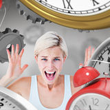 Composite image of angry blonde screaming with hands up Royalty Free Stock Photos