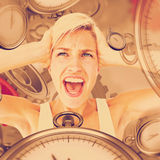 Composite image of angry blonde screaming and holding her head Royalty Free Stock Photo