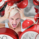 Composite image of angry blonde woman screaming and holding her head Royalty Free Stock Photos