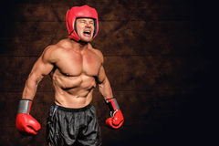 Composite image of angry boxer against black background Stock Image