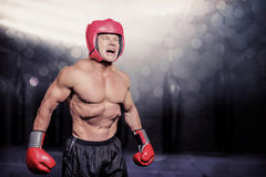 Composite image of angry boxer against black background Royalty Free Stock Images