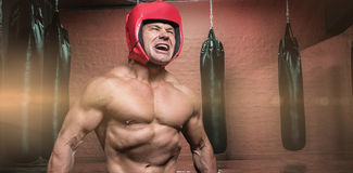 Composite image of angry boxer with headgear Stock Images