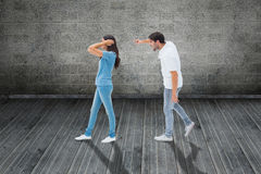 Composite image of angry boyfriend shouting at girlfriend Stock Images