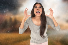 Composite image of angry brunette shouting Stock Image