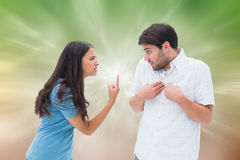Composite image of angry brunette shouting at boyfriend Royalty Free Stock Photo