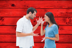 Composite image of angry brunette shouting at boyfriend Stock Photos