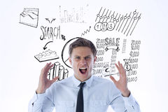 Composite image of angry businessman shouting. Angry businessman shouting against data analysis doodles Stock Photo