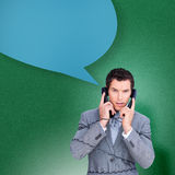 Composite image of angry businessman tangled up in phone wires with speech bubble Royalty Free Stock Photos