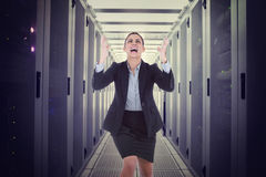 Composite image of angry businesswoman gesturing Stock Image