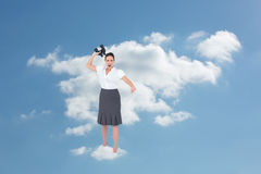 Composite image of angry businesswoman throwing binoculars away Stock Photo