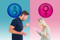 Composite image of angry couple facing off during argument Stock Photography