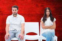 Composite image of angry couple not talking after argument Stock Photography