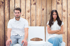 Composite image of angry couple not talking after argument Stock Image
