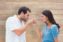 Composite image of angry couple pointing at each other Royalty Free Stock Photography