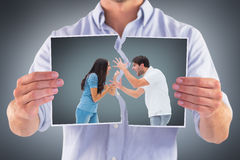 Composite image of angry couple shouting at each other Stock Images