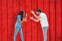 Composite image of angry couple shouting at each other Stock Photography