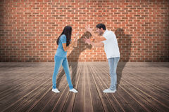 Composite image of angry couple shouting at each other Stock Image