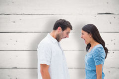 Composite image of angry couple shouting at each other Royalty Free Stock Photos