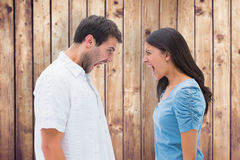 Composite image of angry couple shouting at each other Royalty Free Stock Photo