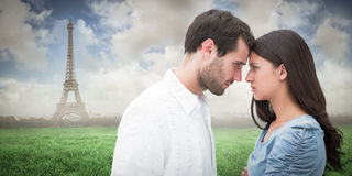 Composite image of angry couple staring at each other Royalty Free Stock Photo