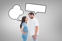 Composite image of angry couple staring at each other Stock Images