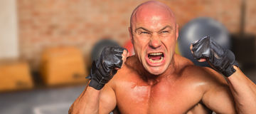 Composite image of angry fighter with gloves Stock Image