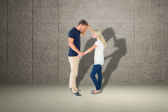 Composite image of angry man overpowering his girlfriend Royalty Free Stock Images