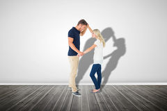 Composite image of angry man overpowering his girlfriend Royalty Free Stock Photo