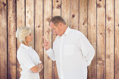 Composite image of angry man pointing at his partner Royalty Free Stock Photo