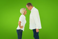 Composite image of angry older couple arguing with each other Royalty Free Stock Images