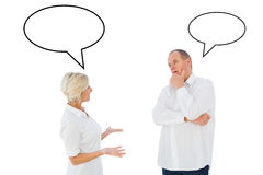 Composite image of angry older couple arguing with each other Stock Image