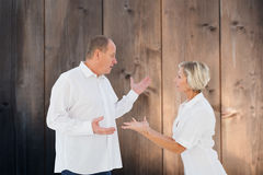 Composite image of angry older couple arguing with each other royalty free stock photography