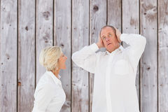 Composite image of angry older couple arguing with each other Royalty Free Stock Photos