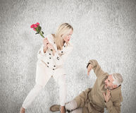 Composite image of angry woman attacking partner with rose bouquet Stock Image
