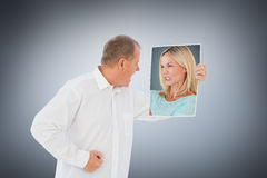 Composite image of angry woman holding piece of paper Royalty Free Stock Image