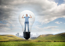 Composite image of angry woman in light bulb Royalty Free Stock Photo