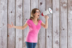 Composite image of angry woman with megaphone and glasses Royalty Free Stock Photos