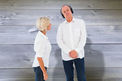 Composite image of annoyed woman being ignored by her partner Royalty Free Stock Photo