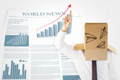 Composite image of anonymous businessman with hand pointing up. Anonymous businessman with hand pointing up against world news sheet with statistics Stock Image