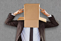 Composite image of anonymous businessman pointing to box Stock Photo