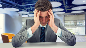 Composite image of anxious businessman. A Anxious businessman against college royalty free stock photography