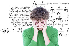 Composite image of anxious casual man looking at camera. Anxious casual man looking at camera  against maths equation Stock Photos