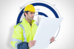 Composite image of architect analyzing blueprint over white background. Architect analyzing blueprint over white background against blueprint Stock Photo