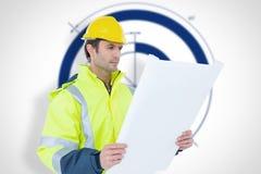 Composite image of architect analyzing blueprint over white background Stock Photo