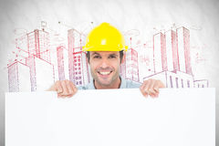 Composite image of architect with bill board over white background Stock Images