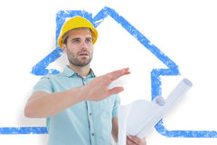 Composite image of architect with blueprint gesturing on white background Royalty Free Stock Images