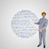 Composite image of architect with hard hat holding plans Royalty Free Stock Image