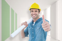 Composite image of architect holding blueprint while gesturing thumbs up Royalty Free Stock Photo